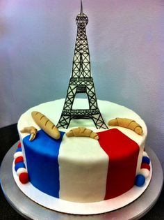 french cake with gum paste eiffel tower, baguette, & croissants, the flag was made of fondant