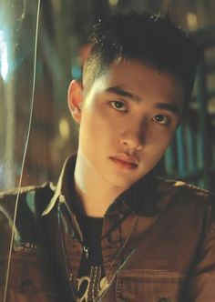 D.O. - He looks like he's grown up and become a handsome biker XD