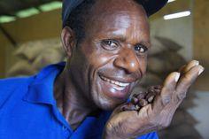 A Papua New Guinea coffee farmer - proud of his Fairtrade cocoa beans