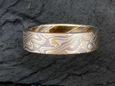 Mokume-gane is a mixed-metal laminate with distinctive layered patterns. The translated meaning is burl metal. The name was borrowed from one type of pattern created in the forging of swords and other edged weapons. Rare Gems, Matching Rings, Polymer Clay Jewelry, Fine Jewelry, Men's Jewelry, Jewellery, Precious Metals, Handcrafted Jewelry, Metal Working