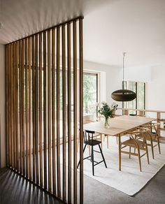 Modern dining space with a heirloom wood room divider -- Article ideas / research - modern room divider ideas for Best of Modern Design - So many good things! Fabric Room Dividers, Bamboo Room Divider, Living Room Divider, Hanging Room Dividers, Folding Room Dividers, Diy Room Divider, Wall Dividers, Modern Room Dividers, Space Dividers