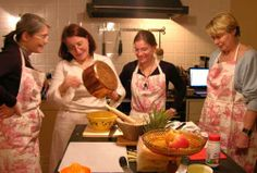 These women are wearing toile and they are having fun cooking together.  It doesn't get any better!     *  Google Image Result for http://www.theinternationalkitchen.com/tik_content/images/lesson/myriam-cooking.jpg