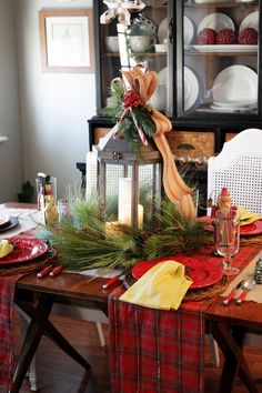 Lovely natural style holiday decor using   fresh pine, accenting with red plaid.  Love the centerpiece