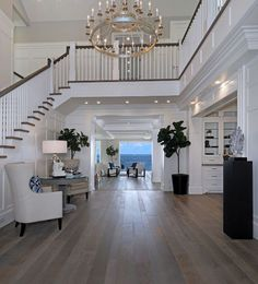 White Cape Cod Beach House Design - - Foyer lighting- Foyer lighting ideas- High ceiling foyer lighting- Foyer Lighting is Currey and Co Lodestar Chandelier – Staircase Lighting Ideas, High Ceiling Lighting, Entryway Lighting, Chandelier Staircase, House Lighting, Wall Lighting, Luxury Lighting, Lighting Design, Foyer Design