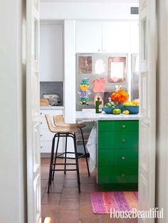 Designers Todd Nickey and Amy Kehoe brought a punch of color to the kitchen by painting the island a rich green — Benjamin Moore's Jade Green.