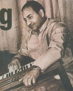 Mohammed Rafi (apparently he did play the harmonium)