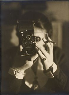 Germaine Krull. Self-Portrait with Cigarette. 1925. Gelatin silver print. Courtesy Stiftung Ann and Jürgen Wilde/Pinakothek der Moderne München. © Estate Germaine Krull, Museum Folkwang, Essen Abbaspour, Mitra, Lee Ann Daffner, and Maria Morris Hambourg. Object:Photo. Modern Photographs: The Thomas Walther Collection 1909–1949 at The Museum of Modern Art. December 8, 2014. moma.org/objectphoto