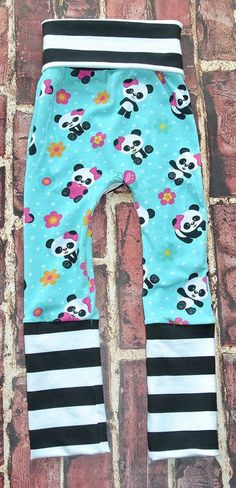 Custom Pandas Maxaloones!  Aka Grow with me Pants. Just roll the waistband and leg bands as your baby grows. A cute bum circle desgined for cloth