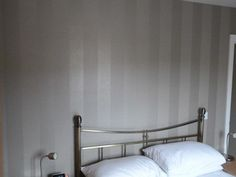 Bedroom decoration by Mr Rodriguez using our 'Galileo' wallpaper in colourway Bronze