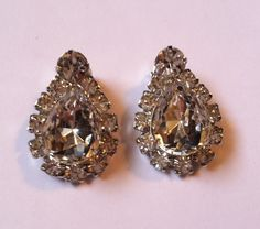 WOW! Big, Bold and Beautiful! These are an amazing pair of sparkling silver tone vintage clip on rhinestone earrings! Very unique and rare!