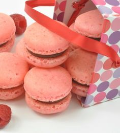 Raspberry Chocolate Ganache Macarons - Tender and delicate, these little lovelies can be found in high-end bakeries all across France. But you don't have to be a world traveler to enjoy. Bring a little Parisian flair to your table with these Raspberry Chocolate Ganache Macarons.