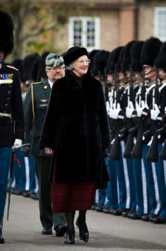 Danish Queen Margrethe II giving the gold watch to the guardsman Joergensen on 20.11.13.