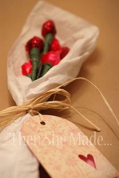 """Hershey Kiss Roses: 2 candy kisses, cellophane paper and a couple of other inexpensive supplies, Voila~ a wonderful single """"rose"""" or a bouquet! Awesome.."""