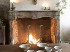 LOVE hand carved and rustic fireplace surround.not perfect, just a bit rustic. French Country Fireplace, French Country Cottage, French Country Style, Rustic Mantle, Wooden Mantle, Vintage Fireplace, Country Charm, French Interior, French Decor