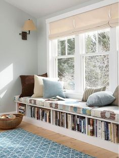 Book Storage Apartments or Small Spaces - love this bookshelf under the window seat! The window seat would make a great reading nook, too, especially with that lamp on the wall above . Interior Design Minimalist, Clean House Schedule, My New Room, Interior Design Living Room, Design Room, Home And Living, Modern Living, Living Rooms, Cozy Living