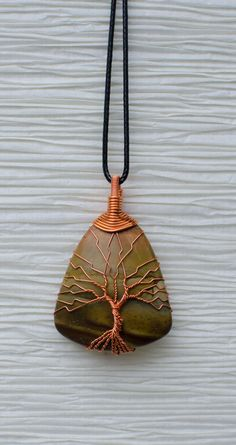 Copper Wire Wrapped Tree of Life wire wrapped around a Brown stone pendant . Pendant is 1.5 inches in length. All wire used in making this
