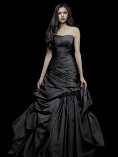 I don't love the gown so much as how her dark hair and bold lip goes with it. Nina Dobrev.