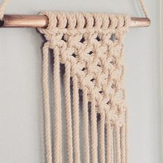 Half Triangle Boho Macrame Wall Hanging of off white cotton cord hanged on copper with fringed bottom. Width 13.5 inches by 31 inches length. Ready to go | Shop this product here: http://spreesy.com/Ellainthemoon/7 | Shop all of our products at http://spreesy.com/Ellainthemoon    | Pinterest selling powered by Spreesy.com