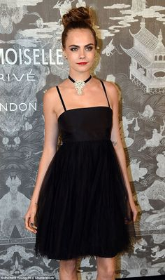 Ballerina chic: The 23-year-old added a  glitzy choker to her black dress, with a full tulle skirt and dainty straps