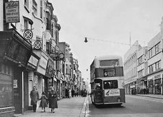 Archive black white photograph of a double decker Bus in Western Road, Brighton, East Sussex (1955)