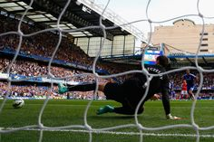 Eden Hazard Photos - Eden Hazard of Chelsea scores the opening goal from the penalty spot past Wojciech Szczesny of Arsenal during the Barclays Premier League match between Chelsea and Arsenal at Stamford Bridge on October 4, 2014 in London, England. - Chelsea v Arsenal - Premier League