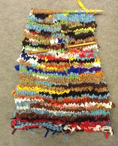 Lou is making a rag rug with our scrap.                                     Gloucestershire Resource Centre http://www.grcltd.org/scrapstore/