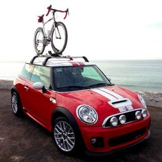 Mini Cooper S with mountain bike rack. I really like the rally lights too.