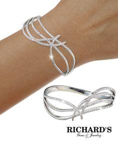 Diamond wave bangle in 18k white gold