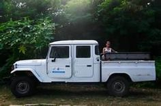 Toyota Land Cruiser BJ 45, the first I have ever seen. I would love this on my 40 with a bench seat.