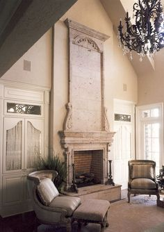 Grand overmantel.... Mediterranean style with a limestone fireplace