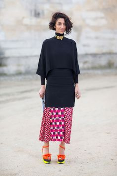 Yasmin Sewell in colourful shoes and calf length skirt, elegant top and oversized choker. Paris Fashion Week, Street style.