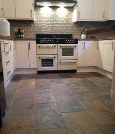 classic open plan kitchen design using slate - kitchen photo
