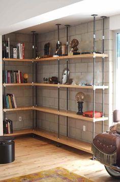 Custom built-in bookcases.Treaded steel shelf supports.Reclaimed wood shelves.
