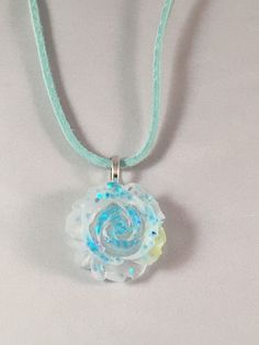 A personal favorite from my Etsy shop https://www.etsy.com/listing/263590937/frosted-rose-resin-pendant-with-blue