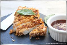 Crispy Breaded Tofu Steaks! Moist and tender tofu, zingy tomato marinade, with a crispy breadcrumb coating. A quick and easy recipe that is perfect for serving with potatoes and veg. Gluten free option. #itdoesnttastelikechicken