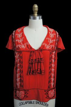 Beaded blouse of red silk, 1920s.