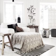 Maybe a little bit too much white for me, but that chair looks perfect for reading a book, an afternoon nap or a spot of crafting :)