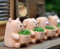 Compra ollas de barro de los animales online al por mayor de China ...
