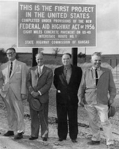 At the November 14 dedication for the US-40 construction west of Topeka, which represents the first paving in the United States under the new Federal-Aid Highway Act of 1956 were, left to right; Ivan Wassberg of Manhattan, commissioner of the first highway division; George Koss, president of Koss Construction Co., the contracting firm; W.S. Mc Daniel, assistant state highway engineer, Topeka; John Beuerlein, Kansas representative of Koss Construction Co. (Location approximate).