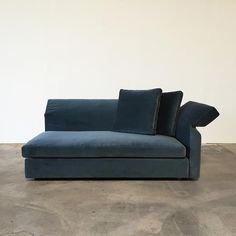 Velvet blue Minotti Collar Sofa for relaxing with a book or meditating our the window. Create a serene modern home decor with the color blue.