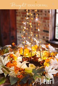 We love this idea! Hang a festive fall wreath with Pier 1's Chandelier Wreath Hanger, and wrap it all in our new Harvest Berry Glimmer Strings® for an interesting new look.