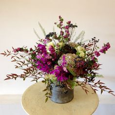Beautifully arranged florals in a green and purple color scheme, perfect for Mother's Day!