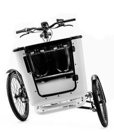 BUTCHERS & BICYCLES: This Danish cargo bike with built-to-tilt capabiity lets you easily turn corners with whole family on board. The box has integrated Isofix mount for attaching an infant car seat and belted seating for two children under 8 years of age. Equipped with a door means that you don't have to lift the kids in and out everytime. Unfortunately, there are currently three B&B dealers in the US :(
