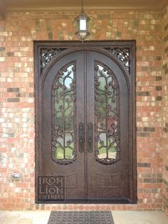 Iron Lion Entries - Custom Tree Design Iron Door install.  Any design is possible!  Turned out great!