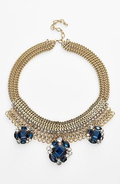 Dressing up a simple fall sweater with this gold and navy crystal cluster statement necklace.