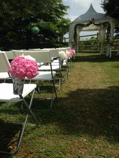 Outdoor ceremony area with pink and white flowers added to the chairs! #luxuryweddingsfrance #frenchweddings #rusticweddings #rustic #weddingideas #weddingsabroad #bellevue #southwestfranceweddings #love #marriage #weddings #countrysidewedding #summerwedding #pinkflowers #outdoorceremony #ceremony