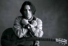 How do you possibly make Johnny Depp hotter? Give him a guitar and a Paul McCartney song.