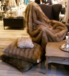 Fur throw and pillows are easily made from vintage fur coats. #furrestyling #fur #throws #pillows #vintagefur #vintage #alaskanfur #homedecor #restyle #repurpose