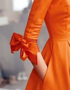 Nothing I don't love, from the color (looks like orange juice) to the trim waist to that el-bow.  Isaac Mizrahi