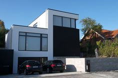 Modern Danish house. Like the black and white cleanness.